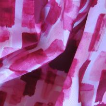 Tessuto cotone rosa e rosso effetto pennello impressionista