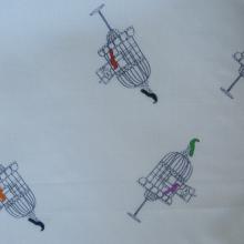 tessuto di cotone a fantasia con uccellini e gabbiette