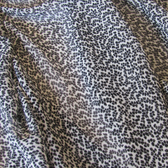 polyester fabric with a black and white pattern