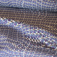 polyester fabric with a purple, turquoise and khaki pattern