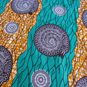 wax Supreme fabric orange turquoise and brown coloured