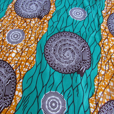 wax Supreme fabric orange turquoise and brown coloured