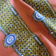 wax Supreme fabric apricot and mustard coloured