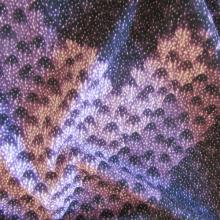 felpa di cotone viola con motivi geometrici