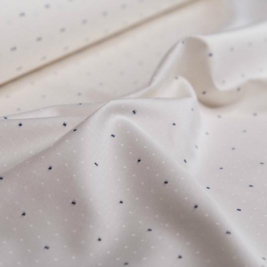 tessuto di  cotone avorio con punti neri