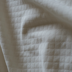 White cream quilted jersey fabric
