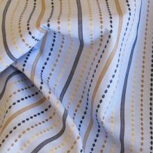 Tessuto di cotone azzurro a righe blu e dorate