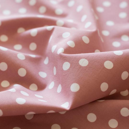 Tessuto di cotone rosa antico pois