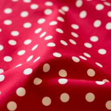 Tessuto di cotone rosso pois
