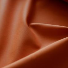 Orange cotton sateen fabric with stretch