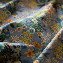 Tessuto di cotone canvas blu con fiori turchese ed ariancione