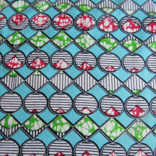 Super Wax fabric Lolo Elegance light blue, red and green coloured