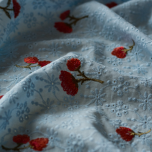 Sky blue broderie anglaise cotton fabric with embroidered flowers