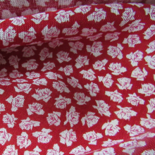 Red linen fabric with roses