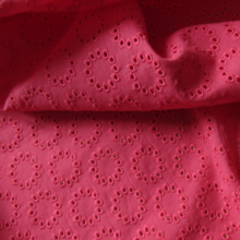 Raspberry broderie anglaise cotton fabric