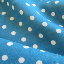 Turquoise linen fabric with polka dots