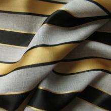 Gold beige striped cotton fabric