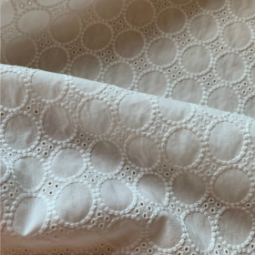Ivory broderie anglaise cotton fabric