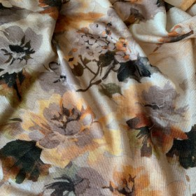 Caramel colored Viscose jersey fabric floral pattern